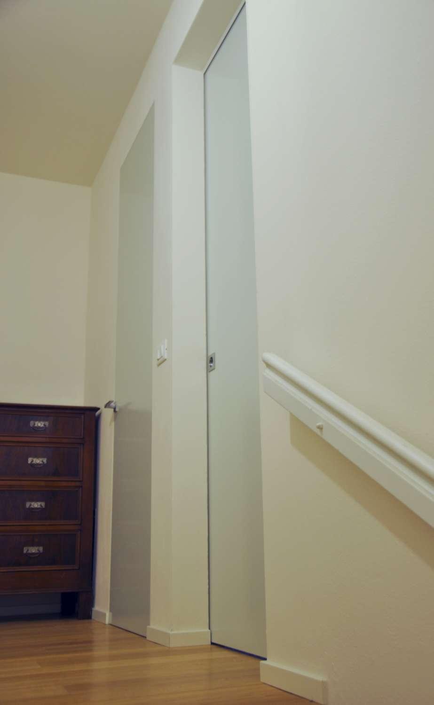 Porta legno laccato raso muro battente e scorrevole a scomparsa minimale (4)-1500